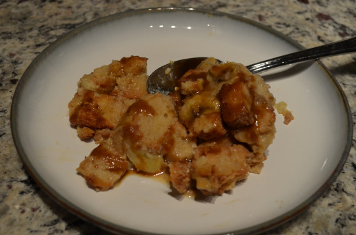Bananas Foster Bread Pudding topped with Warm Spiced Rum Sauce.