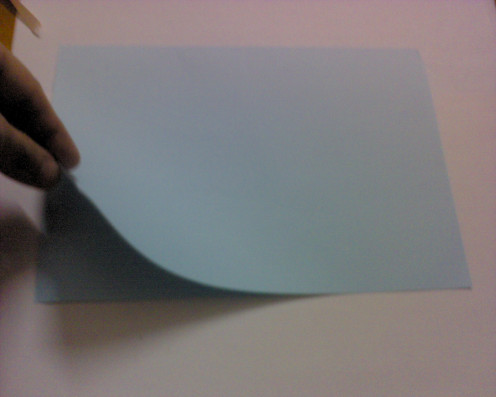 fold the card into half, from top to bottom