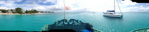Panoramic view from the top of a glass bottomed boat that took us swimming with green-shelled turtles