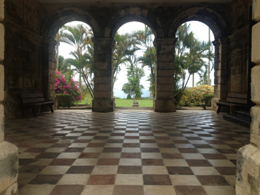 The view of the formal back gardens through the arches at Codrington