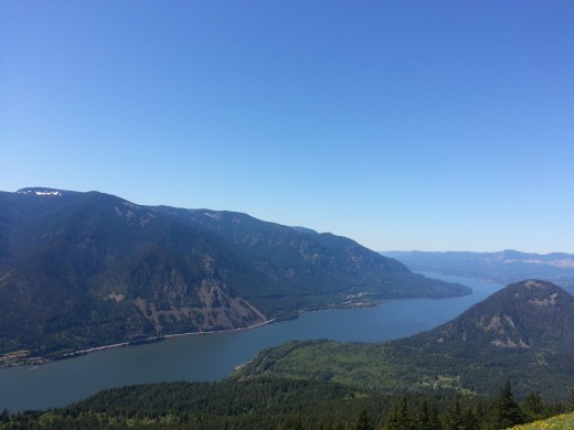 Mountains and hills peak along the Columbia River Gorge.