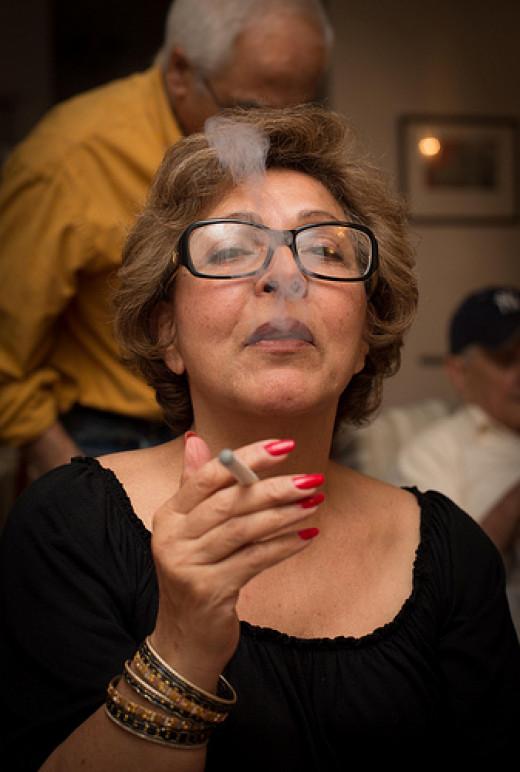 woman with e-cig. no smoke, no smell and no need to go outside to smoke.