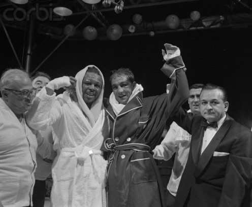 Boxing manager Al Weill flanks Archie Moore and his champion Rocky Marciano. He did anything in his power to gain advantages for his fighters.