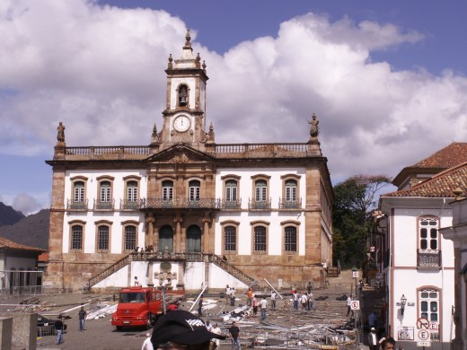 Prominant Church in Ouro Preto, Brazil.  Cleanup from a recent party is taking place in this picture.