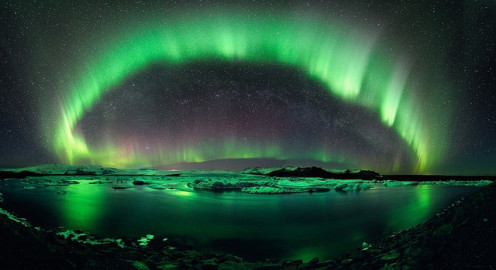 Aurora Borealis, Northern Lights; often enhanced by CMEs.