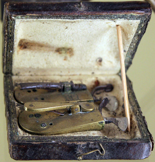 A barber-surgeon's bag and surgical instruments from the 19th century.