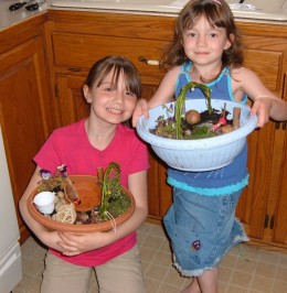 Two of my grand daughters with their fairy gardens.