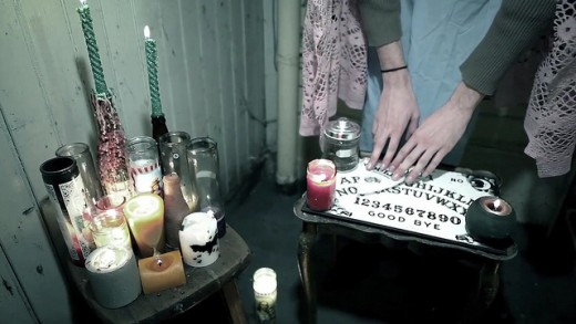 A woman using an ouija board...she is clearly using tools to protect herself.