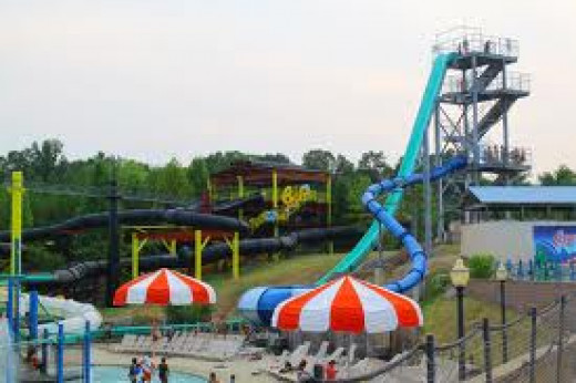 Splash Waterpark in Bessemer, Alabama has many deep slides and also curvy slides that are complete tubes.