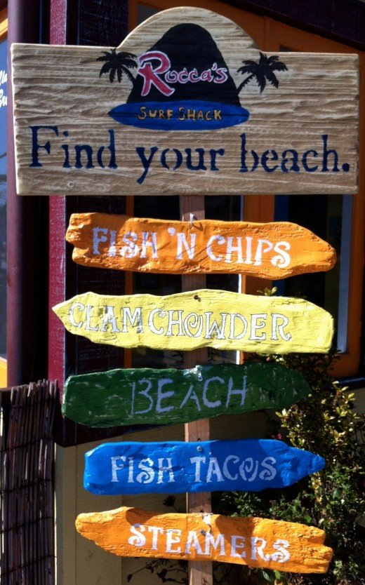 A sign outside of another restaurant, Rocca's Surf Shack.