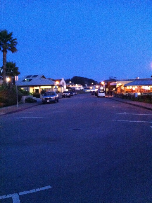 The embarcadero at night in Morro Bay.
