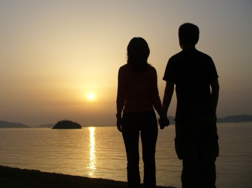 Couple Holding Hands in the Sunset