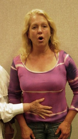 Inflate the abdomen centered at the waistline each time you inhale air.  Release the air slowly as you sing.