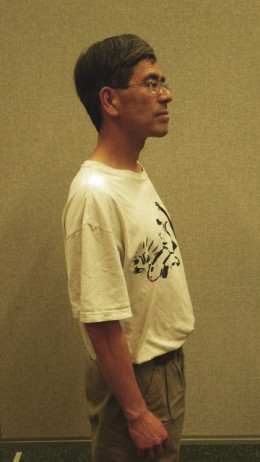 Proper posture - shoulders are back, chest is high, neck and spine are aligned.