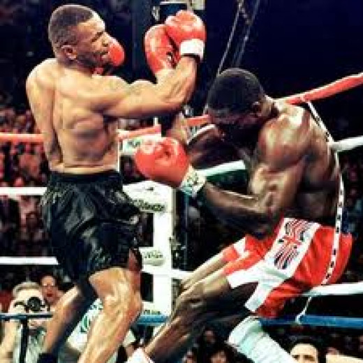 Mike Tyson knocked out Frank Bruno in three rounds in their rematch. The victory made Iron Mike a two time heavyweight champion.