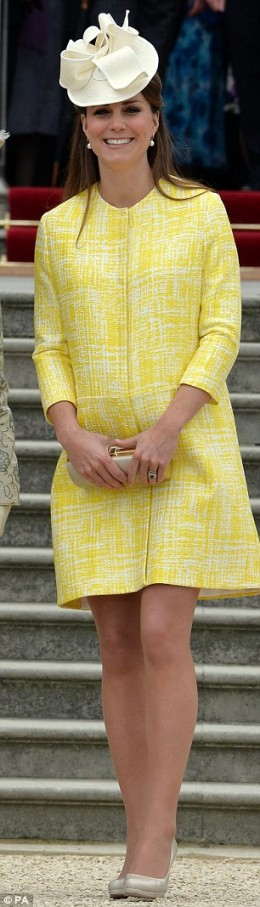 Canary yellow coat by Emilia Wickstead
