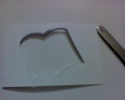 cut out the book shape, top and bottom- a see through hole