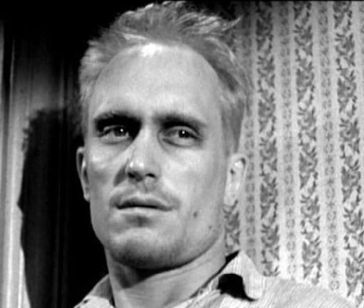 Boo Radley, portrayed by Robert Duvall, in the film of Lee's novel.  This was Duvall's  first film role.