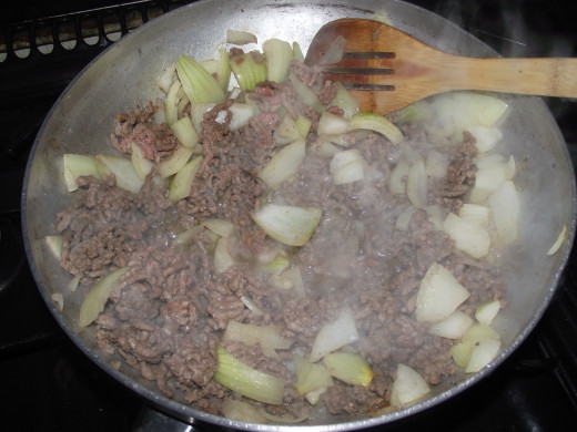 brown mince, add onion and spice