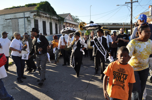 Second Lines truly are celebrations- cheerful for the most part, with dancing and singing to honor the dead.