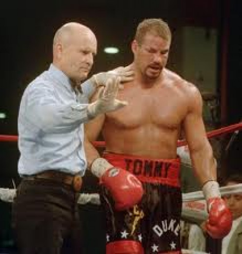 Referee Mills Lane was the third man in many big bouts in the prize ring. In this photo Lane stops Tommy Morrison from taking further punishment and awards Lennox Lewis a 5th round knockout.