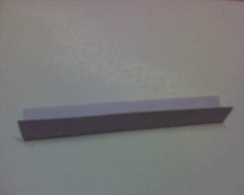a strip of purple paper that has the similar width of the front card