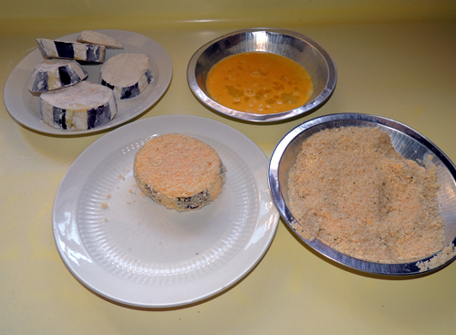 then dip into egg, dip into bread crumbs, and press crumbs firmly into flesh