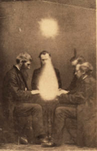 Men participating in a seance in Bristol, England.  (1872)