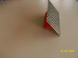 Toothed tool, normally used to roughen a surface before a second coat