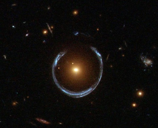 Light from a galaxy behind the black hole takes a ring shape due to gravitational lensing