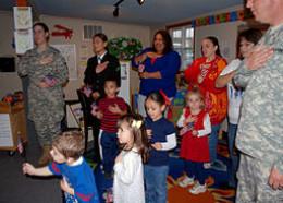 U.S. service members pledge allegiance with preschoolers.