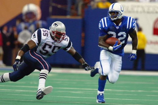 Willie McGinest tackles Edgerrin James