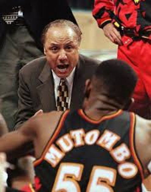 Mutombo getting an earful from Lenny Wlkens, who played himself before becoming a coach.