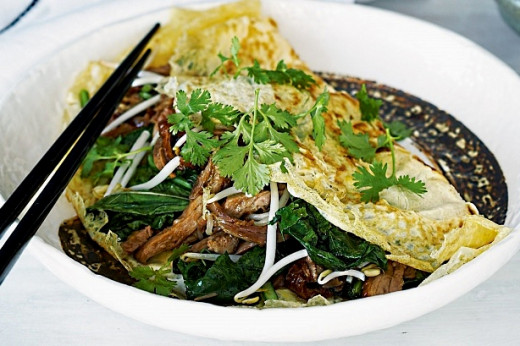 Asian style omelettes are full of fresh vegetables and herbs