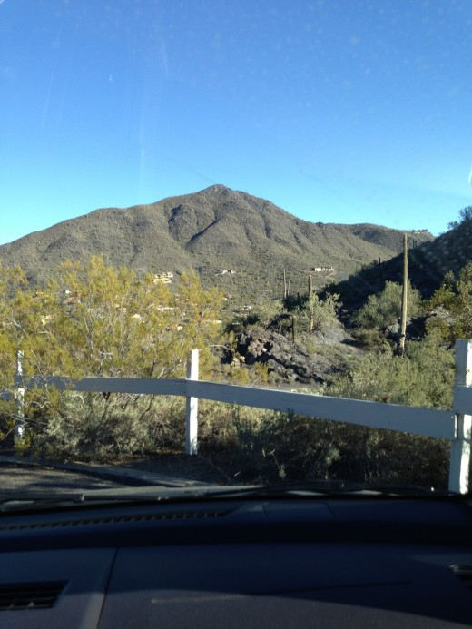 Touring through Arizona with My Dear Wife. That is Black Mountain (one of many in AZ) up ahead.