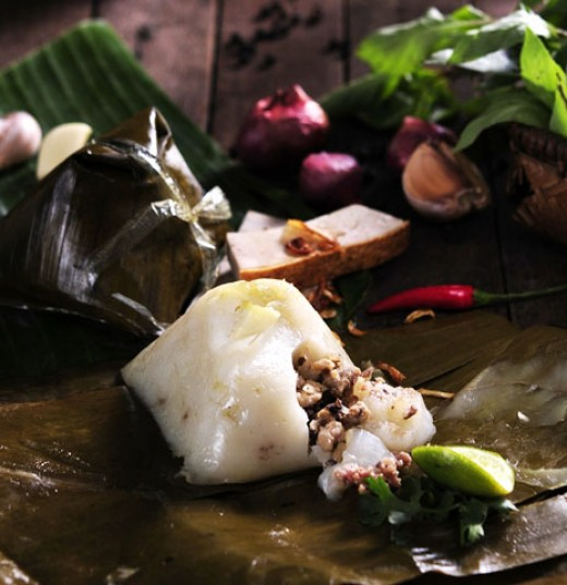 hot Banh Gio is traditionally wrapped in banana leaf in a pyramidal shape and to be served with chili sauce or by itself.