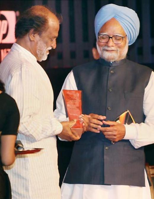 Rajnikanth receiving award from Prime Minister Manmohan Singh