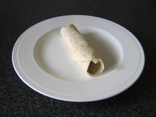 Spicy pork, pineapple and green bean tortilla wrap ready to eat