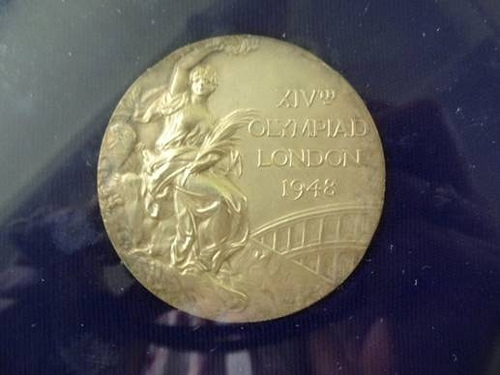 Bill Smith's 1948 Olympic Gold Medal in the men's 400 meter free style. He trained in this natatorium.