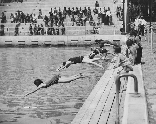 Young women diving in the long ago past.