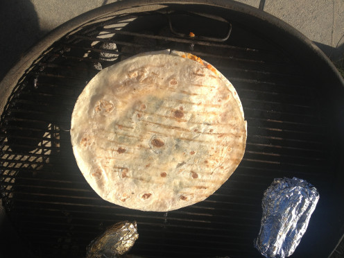 Place another tortilla on top and return to grill directly over low burning coals