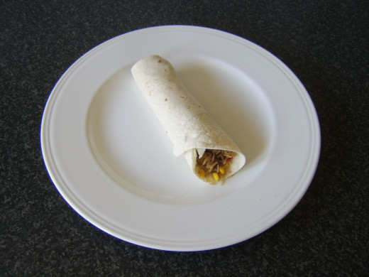 Rolled wrap is plated with the fold down and is ready to serve