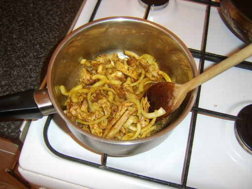 Pork and onion are stir fried in spices