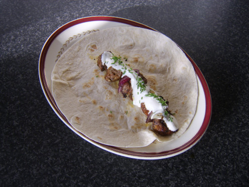 Jamaican jerk spiced pork, apple and red onion shish kebab served in a tortilla wrap with soured cream