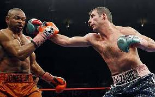 Joe Calzaghe hits Roy Jones with a southpaw jab.