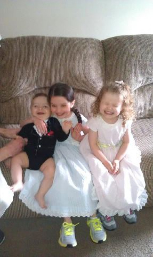 All dressed up, and wearing their tennis shoes :)  Look at poor little Landon, smiling while being hugged a little too tight around his neck by his older sis!