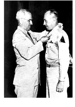 Turner at his awards ceremony with President Truman.
