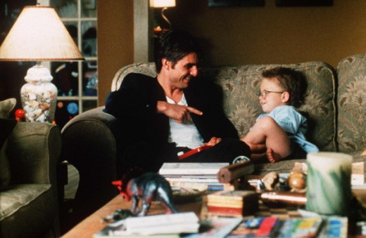 Jerry McGuire and his love interest's son have a good talk on her couch.