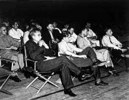 A group of physicists at a 1946 Los Alamos colloquium. In the front row are Norris Bradbury, John Manley, Enrico Fermiand J.M.B. Kellogg (L-R). Oppenheimer is in the second row on the left; Richard Feynman is seated on Oppenheimer's left.