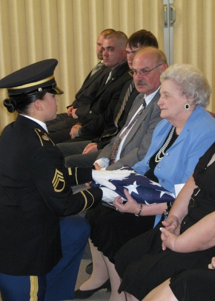 Presenting the flag to the widow of a WWII veteran.